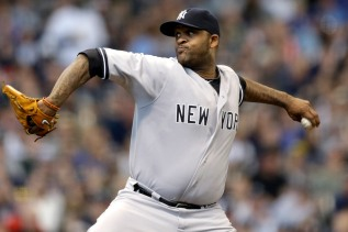 New York Yankees starting pitcher CC Sabathia throws to the Milwaukee Brewers in the first inning of a baseball game Saturday, May 10, 2014, in Milwaukee. (AP Photo/Jeffrey Phelps)