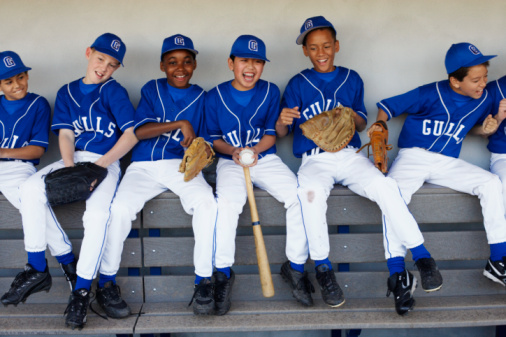 Youth_baseball_team_having_fun_in_dugout_1-1
